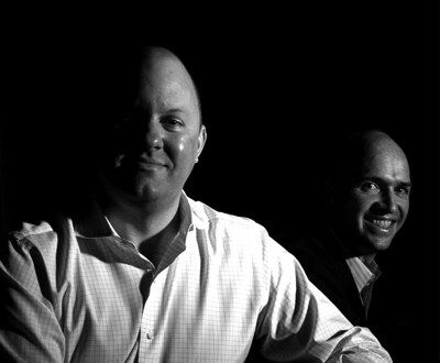 Photo of Marc Andreessen and Ben Horowitz, who are pleding half their income to charity