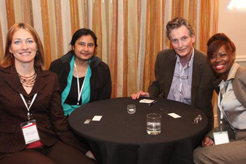 Mary Vincent (far left) with GreenBeat 2009 conference attendees, including Sonalee Henriette (far right) of GreenSPHERE Energy