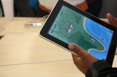 Playing games on Apple's iPad tablet.