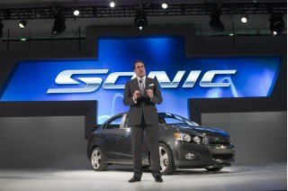 GM's Mark Reuss with 2012 Chevrolet Sonic at 2011 Detroit Auto Show