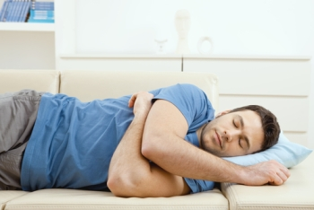 man sleeping on a couch