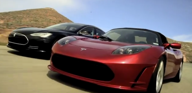 Tesla Model S and Roadster driving on a road together
