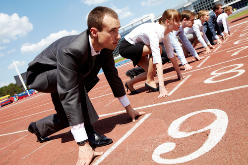 Stock photo of business people at a starting line