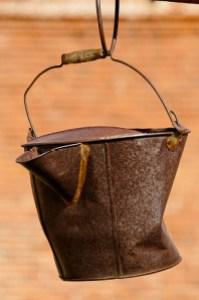 photo of an old rusty bucket