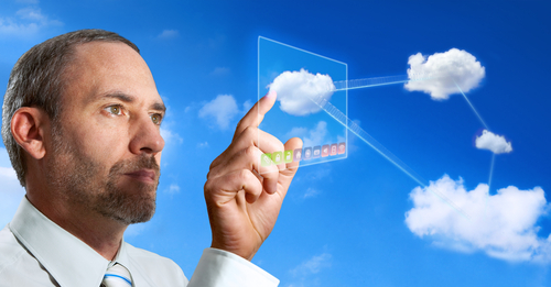 Businessman pointing at a cloud diagram