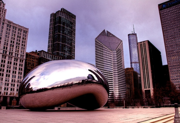 photo of Cloud Gate, a reflective sculpture, and the Chicago skyline