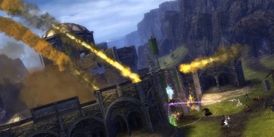 Trebuchet shots rain down on a stronghold under siege in Guild Wars 2's World vs. World mode.