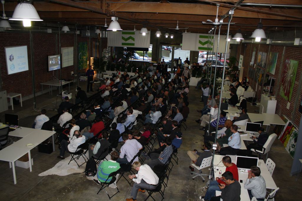 A crowd of people listen to enteprises present at 2020.vc on what problems they need to solve