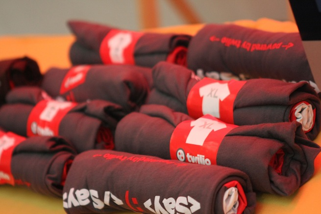 Photo of a pile of Twilio T-shirts