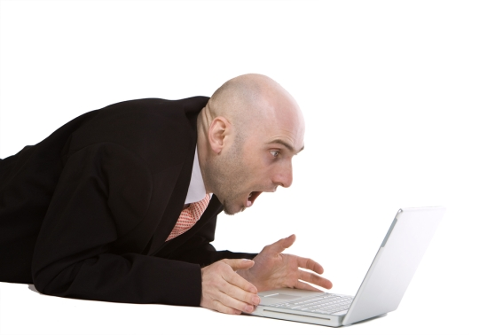 Shocked man with computer