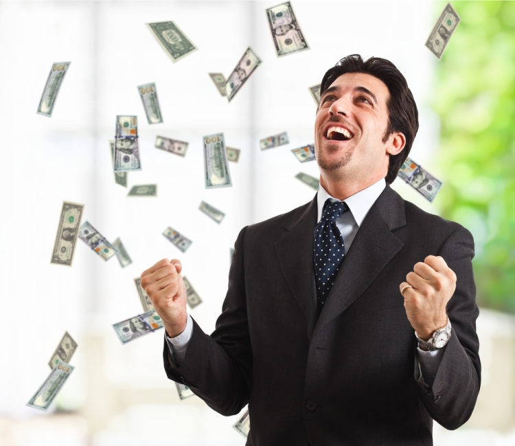Man standing with cash raining