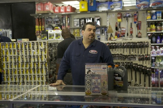 Joe Ferrer, owner of BS&F Auto Parts, worries that hybrid and electric cars could put him out of business
