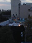Workers on the roof of what appears to be Apple's new Palo Alto, Calif. store, at 7am on Saturday morning
