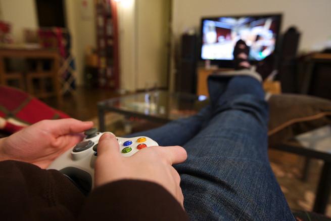 Man playing Xbox 360