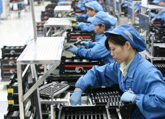 Seagate factory workers assemble 2.5-inch hard drives