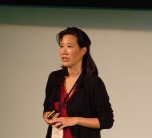 Eileen Burbidge speaking at a conference