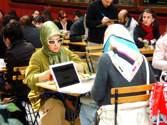 Two young Muslim women with a Macbook in Istanbul represent the growing sophistication of Turkey's e-commerce market.