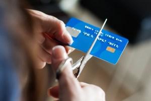 Hands cutting a creditcard