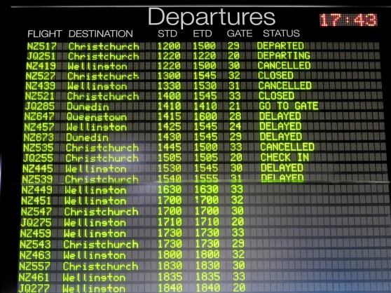 departures board showing many canceled flights