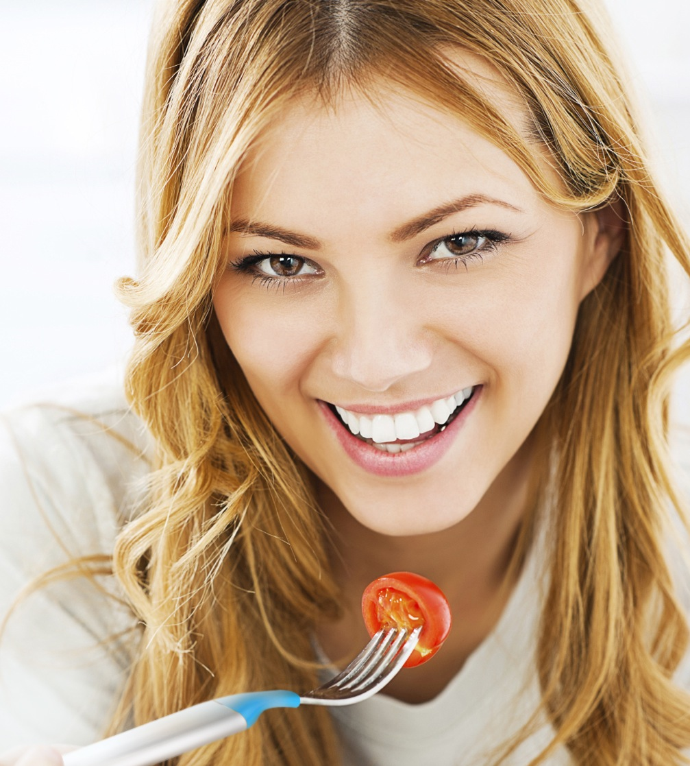 Close-up of a woman eating healthy food.