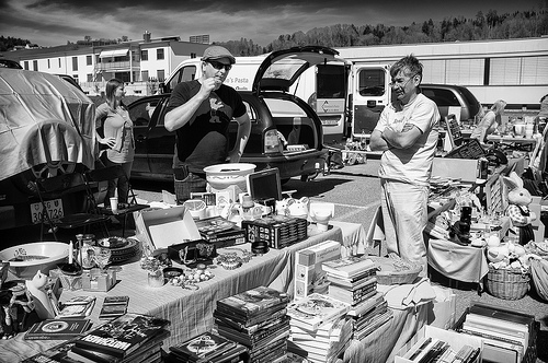 People and stuff at a flea market