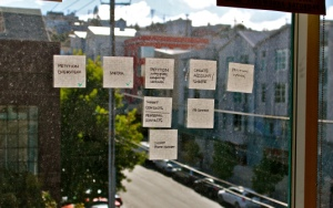 Remnants of a brainstorm on a dusty window at Change.org's San Francisco office.