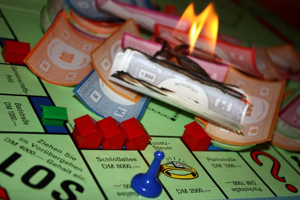 monopoly money cash burning