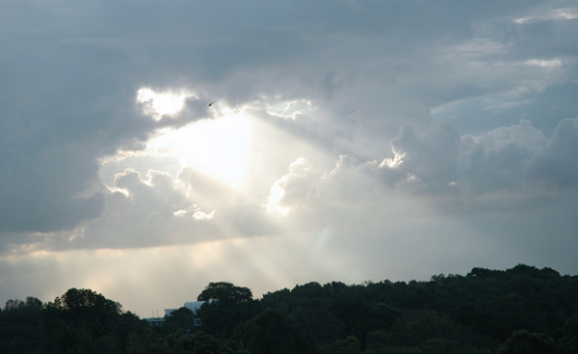 Photo of light shining through a cloud