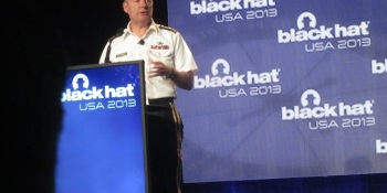 NSA chief stands up for surveillance, fends off hecklers