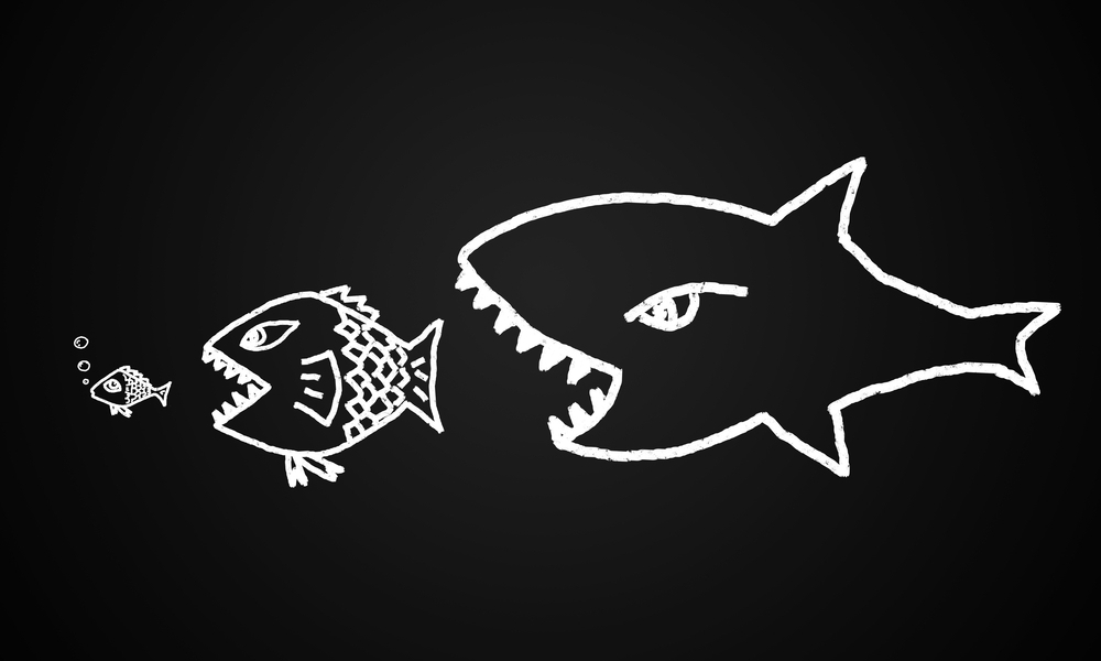 Drawing of big fish eating little fish