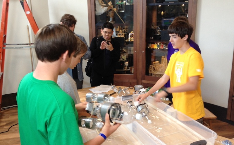 Young makers work on a soda-bottle boat project at the Exploratorium, as part of the Google Maker Camp 2013.
