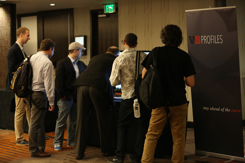 People at the CloudBeat conference check out a demo of the new VentureBeat Profiles.