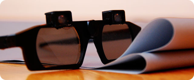 CastAR glasses with its head-mounted projectors.