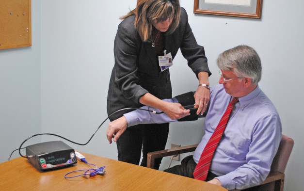 ‎Transitional Care Manager Michele Sandock shows off a new telehealth unit