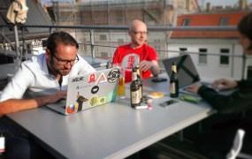 Members of the 6Wunderkinder team work on a Berlin rooftop