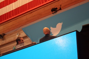 Patrick Stewart examines the Twitter logo as he stands next to Vivienne Harr, who helped him ring the opening bell.