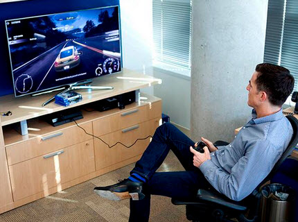 Andrew Wilson plays Need for Speed on a PlayStation 4.