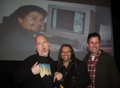 Doom co-creators hold the chainsaw that made it into the game.