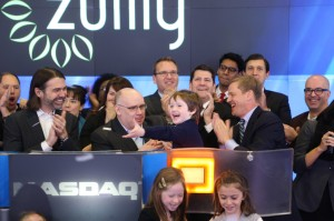 Darrell Cavens of Zulily with his son and early employees, opening trading on Nasdaq this morning