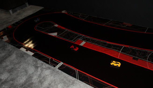 Anki Drive AI car chases a human-driven car in a battle of wits.