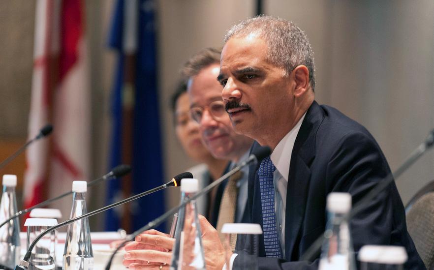 U.S. Attorney General Eric Holder (right)