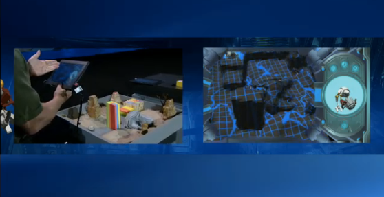 A demonstration game: an Intel employee points a tablet at a sandbox (left) and the tablet renders the sandbox in 3D (right).