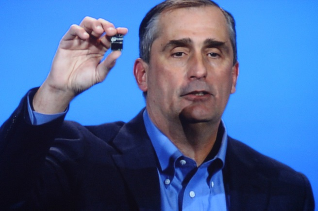 Intel CEO Brian Krzanich holding up Intel's new Edison chip for wearables.