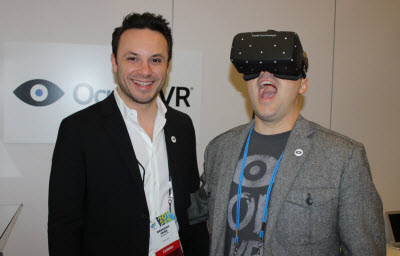 Brendan Iribe and the masked Oculus face of Aaron Davies, head of developer relations.