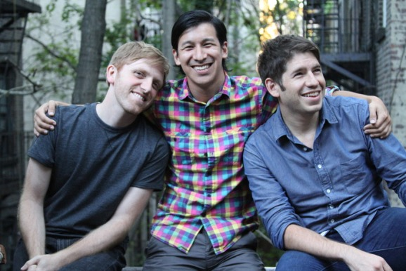Kickstarter chairman and former CEO, Perry Chen (center), sits with his co-founders Yancey Strickler (right) and Charles Adler (left).