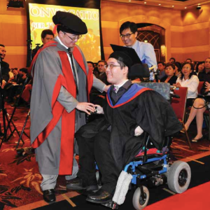 Albert Wong graduating from university with a law degree