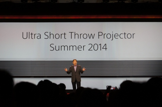 Sony CEO Kaz Hirai in front of its short-range 4K projector