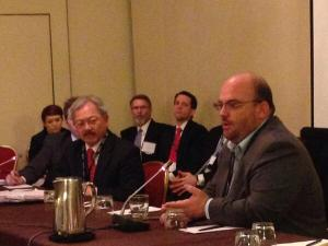 Marc Roth addressing city mayors in D.C.