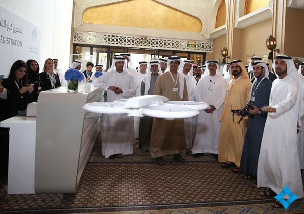 UAE Prime Minister Sheikh Mohammed attends early tests of the drones that will deliver government parcels.