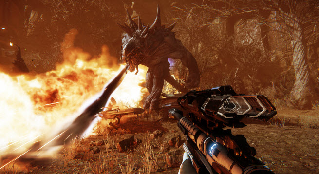 Sniper shoots at a monster in flames in Evolve